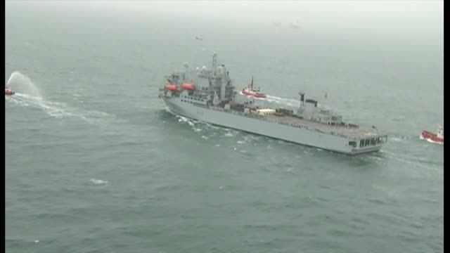 the rfa argus departs falmouth for sierra leone. shows exterior shots aerials rfa argus on the sea following tug boats. on october 17, 2014 in... - 英国海兵隊点の映像素材/bロール