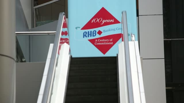 The RHB Investment Bank Bhd logo is displayed at the trading gallery at the RHB Investment Bank Bhd headquarters in Kuala Lumpur Malaysia on Monday...