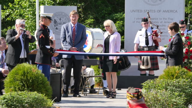 the ribbon is cut to dedicate a new war memorial during memorial day ceremonies at valhalla memory gardens may 29 2017 in bloomington ind a new war... - veterans of foreign wars of the united states stock videos & royalty-free footage