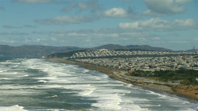 The Richmond and Sunset districts of San Francisco overlook the long waves of the Pacific Ocean as they lap the coast.