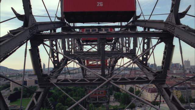 the riesenrad ferris wheel turns slowly over vienna. - prater park stock videos & royalty-free footage