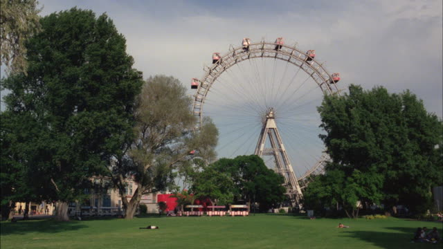 the riesenrad towers over the prater park in vienna, austria. - prater park stock videos & royalty-free footage