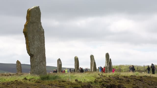the ring of brodgar an ancient neolithic stone circle on orkney completely over run with tourists from cruise ships that now call in at orkney... - circle stock videos & royalty-free footage