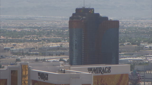 The Rio All Suite Hotel and Casino towers behind the Mirage Hotel and Casino in Las Vegas, Nevada.