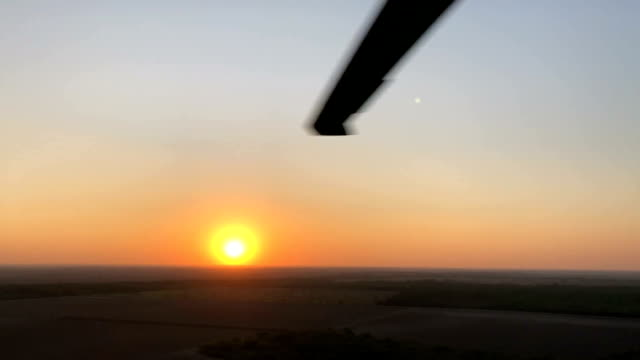 the rio grande flows along the u.s.-mexico border at dusk, as seen from a u.s. air and marine operations helicopter patrol on november 6, 2018 in... - mcallen texas stock videos & royalty-free footage