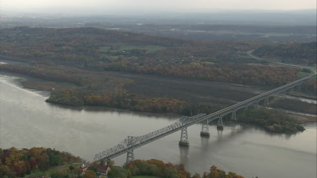 aerial the rip van winkle cantilever bridge spanning the hudson river / new york, united states - cantilever bridge stock videos & royalty-free footage