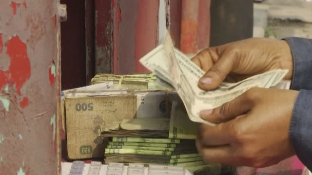 the rise of the dollar against the congolese franc is causing prices to soar in the democratic republic of congo hitting consumers' purchasing power... - financial item stock videos & royalty-free footage