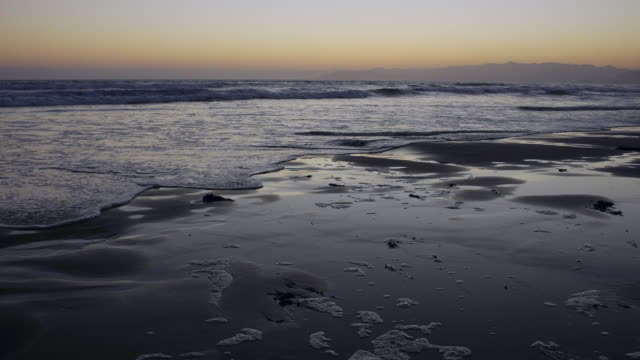 The rising tide at dusk on Pismo Beach