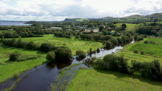 the river belcoo which forms the border between northern ireland and the republic of ireland runs past the remains of a railway bridge blown up by... - ireland stock videos & royalty-free footage