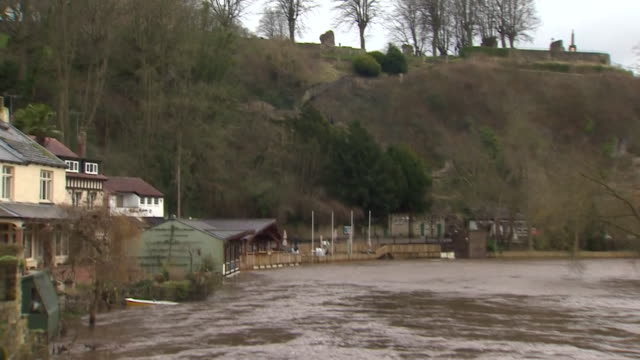 the river nidd in knaresborough at high level fast flowing and at risk of flooding after heavy rainfall - knaresborough stock videos & royalty-free footage