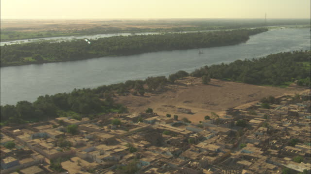 the river nile flows past a city in egypt. - middle east stock videos & royalty-free footage