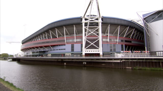the river taff flows past the millenium stadium in cardiff. available in hd. - cardiff wales stock videos & royalty-free footage