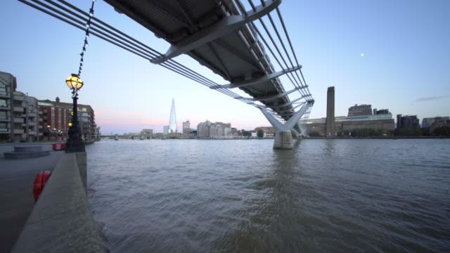 the river thames, and millennium bridge. - london millennium footbridge stock videos and b-roll footage
