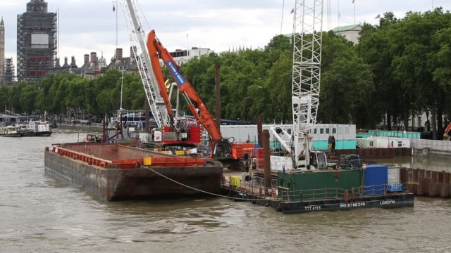 the river thames at high tide, showing how vulnerable london is too flooding from storm surge and sea level rise. at high tide the water is higher... - physical geography stock videos & royalty-free footage