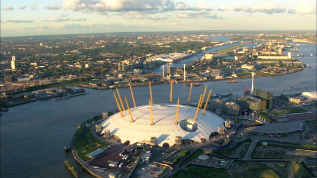 the river thames flows between the london city airport and the o2 arena in north greenwich, london. - the o2 england stock videos & royalty-free footage