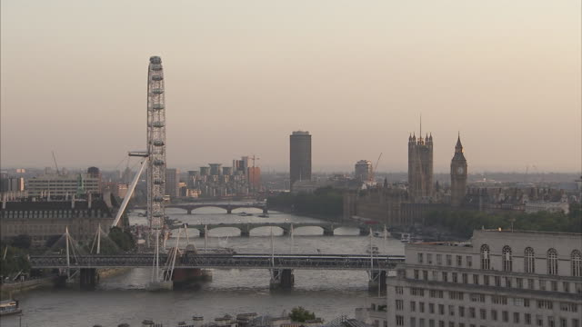 the river thames flows past the london eye houses of parliament and under hungerford westminster and lambeth bridges available in hd. - lambeth stock videos & royalty-free footage