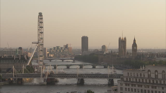 the river thames flows past the millennium wheel houses of parliament and under hungerford westminster and lambeth bridges london available in hd. - lambeth stock videos & royalty-free footage