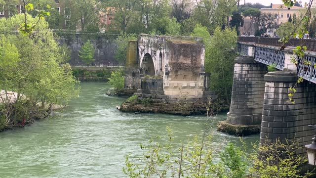 the river tiber flows under the pons aemilius on april 16, 2021 in rome, italy. today the bridge is called ponte rotto. it is the oldest roman stone... - pons stock videos & royalty-free footage