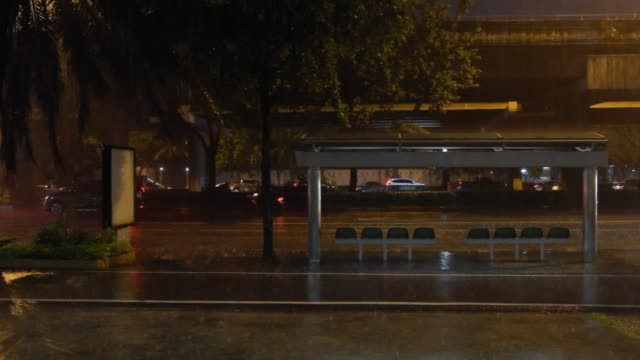 the road that drives in the rainy night. - bus stop stock videos & royalty-free footage