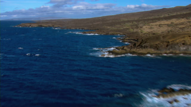 The rocky, rugged shoreline of Maui reaches into the vivid blue waters of the Pacific Ocean.