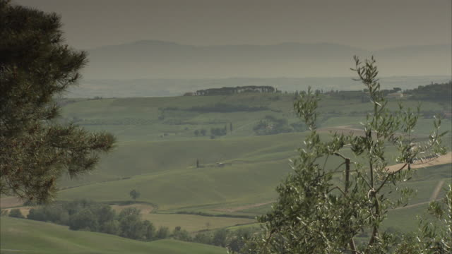 the rolling hills of montepulciano extend towards the horizon. - montepulciano stock videos & royalty-free footage