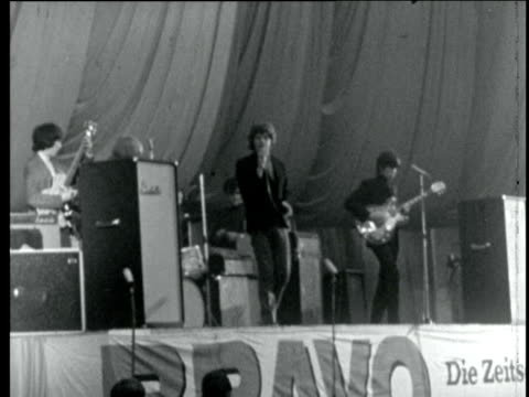 the rolling stones concert in hamburg w germany hamburg ms side the rolling stones on stage ms 2 girls fans in caps ms side fans keep time ms the... - 1965 stock videos & royalty-free footage