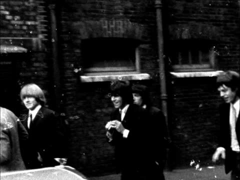 the rolling stones go to court; england: london: west ham: west ham court ext the rolling stones walk r-l rolling stones walk r-l stand - rolling stones stock videos & royalty-free footage