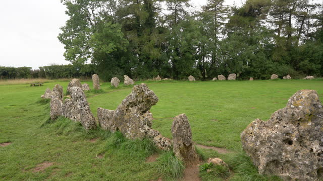 the rollright stones. the king's men stone circle is late neolithic, circa 2,500 bc - obelisk stock videos & royalty-free footage