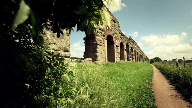 the roman aqueduct at parco degli acquedotti - aqueduct stock videos and b-roll footage