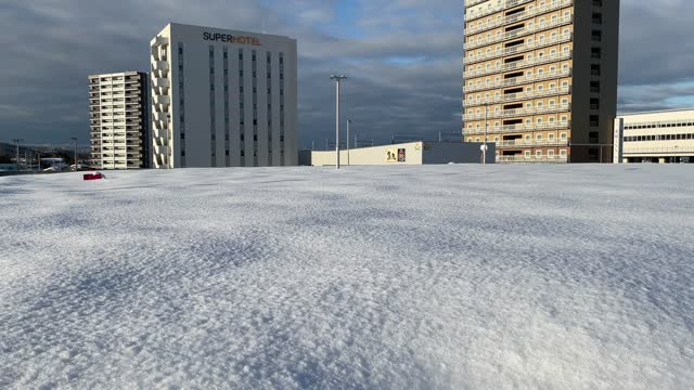 the roof of a car park is blanketed in the snow on january 20 in joetsu, japan. parts of northern japan have been hit by unexpectedly heavy snow in... - cold temperature stock videos & royalty-free footage