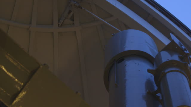 the roof of an observatory closes over a telescope - astronomy stock videos & royalty-free footage