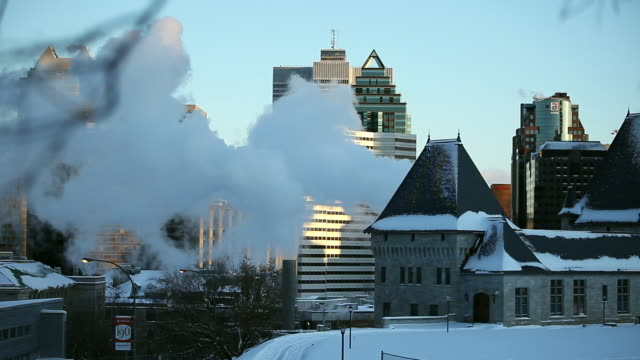 the roofs of some building and skyscrapers in city of montreal. smoke coming out - montreal stock videos and b-roll footage