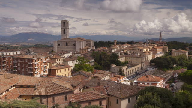 the rooftops of perugia, italy. basilica di san pietro and basilica di san domencio are seen in the background. - perugia stock videos & royalty-free footage