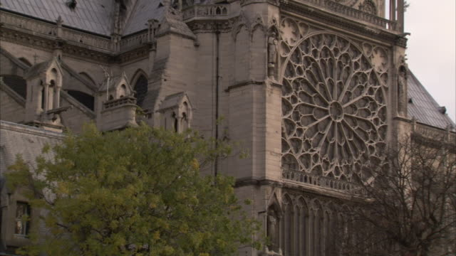 the rose window decorates the facade of notre dame cathedral in paris. available in hd. - notre dame de paris stock videos and b-roll footage