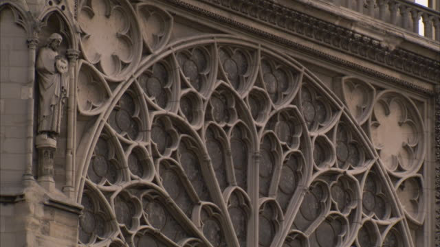the rose window decorates the facade of notre dame cathedral in paris. available in hd. - rose window stock videos and b-roll footage