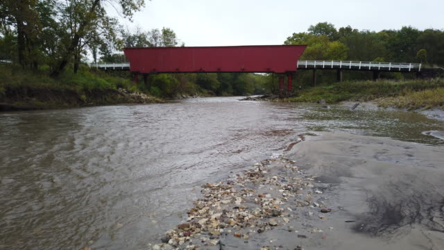 the roseman covered bridge that was built in 1883 is seen on october 10, 2019 in winterset, iowa. the 2020 iowa democratic caucuses will take place... - überdachte brücke brücke stock-videos und b-roll-filmmaterial