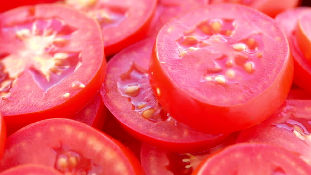 the rotating tomato slices - chopped food stock videos and b-roll footage