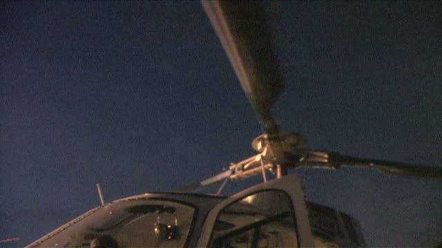 The rotor of the helicopter turns.