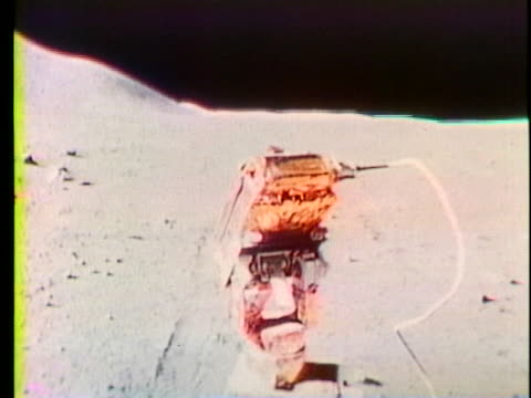 the rover drives across the moon's surface. - impatto video stock e b–roll