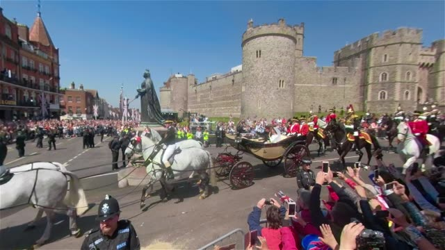 the royal couple ride out of windsor castle in an open top carriage after at the royal wedding 2018 prince harry and ms meghan markle on may 19 2018... - carriage stock videos and b-roll footage