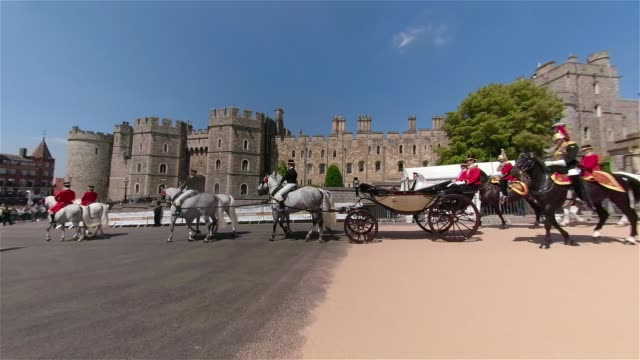 the royal couple ride out of windsor castle in an open top carriage after at the royal wedding 2018 prince harry and ms meghan markle on may 19 2018... - cocchio video stock e b–roll