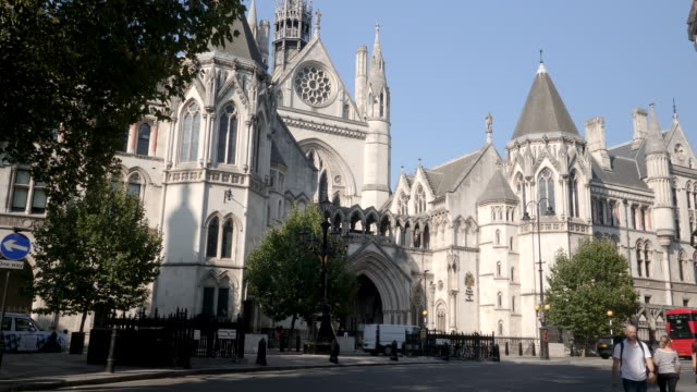 the royal courts of justice in london, england, uk. side view, quiet day with very few people of traffic due to the coronavirus lockdown - law stock videos & royalty-free footage