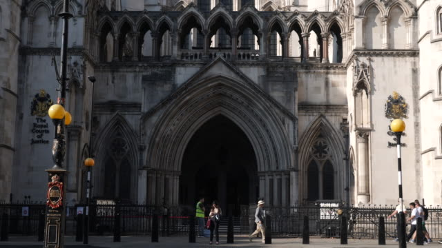 the royal courts of justice in london, england, uk. slow motion bus traffic and people walking past. - justice concept stock videos & royalty-free footage