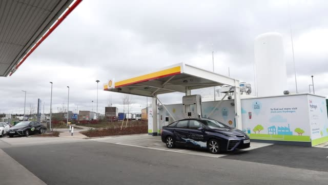 the royal dutch shell plc logo sits above the company's first uk hydrogen refueling station in cobham uk on wednesday feb 22 a mirai hydrogen fuel... - fossil fuel stock videos & royalty-free footage