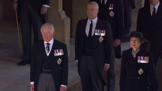the royal family, including prince charles, princess anne and prince andrew, watch as their father's coffin, duke of edinburgh, is placed on the land... - mourning stock videos & royalty-free footage