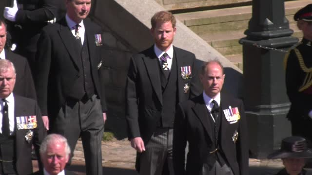 the royal family walk in procession behind a land rover hearse carrying the duke of edinburgh's coffin to the funeral service at st george's chapel,... - funeral stock videos & royalty-free footage