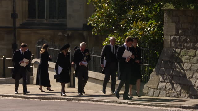 """the royal family walking back to windsor castle together after the funeral of prince philip, the duke of edinburgh - """"bbc news"""" stock videos & royalty-free footage"""
