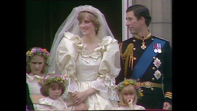the royal family wave from the buckingham palace balcony on the day of the wedding of prince charles and lady diana spencer; 1981. - balcony stock videos & royalty-free footage