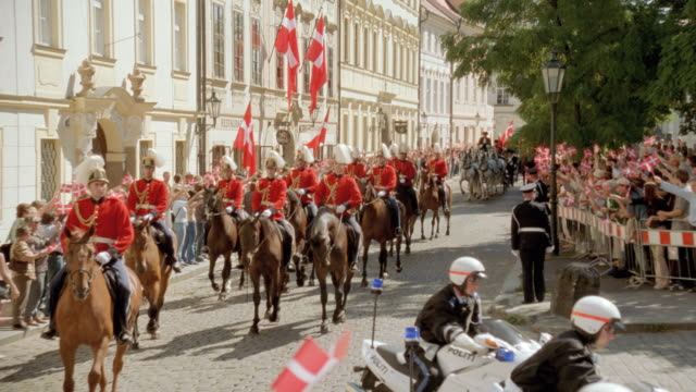 the royal guard of denmark rides their horses in a parade for a cheering crowd. - denmark stock videos & royalty-free footage