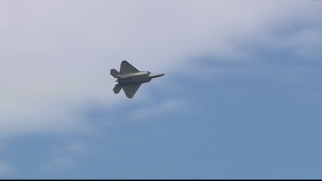 the royal international air tattoo air show took place at raf fairford on friday 8th of july 2016 shows a lockheed martin f22 raptor flying overhead... - raf fairford stock videos and b-roll footage